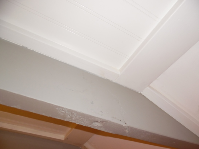 Creating beautiful drop beam ceilings in an old home.